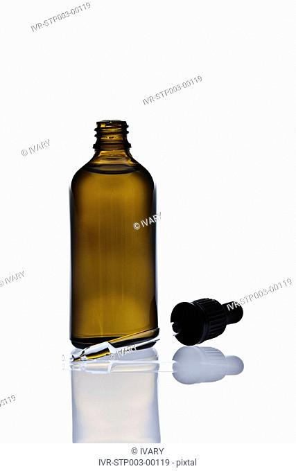 Bottle And Dropper With White Background And Reflection