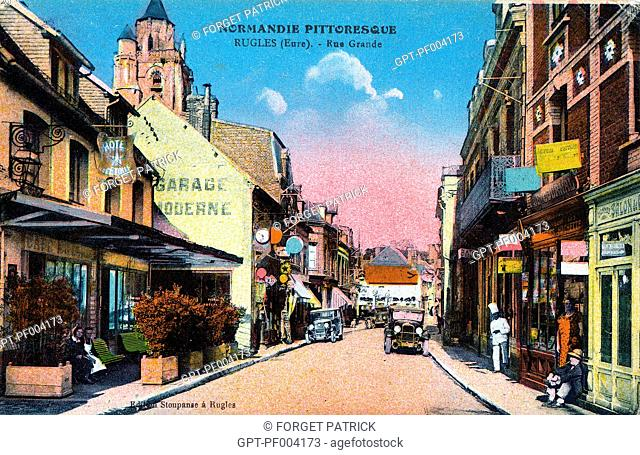 THE MAIN STREET WITH ALL ITS SHOPS, COLORED OLD POSTCARD, COLLECTION OF THE CITY OF RUGLES, EURE (27), FRANCE