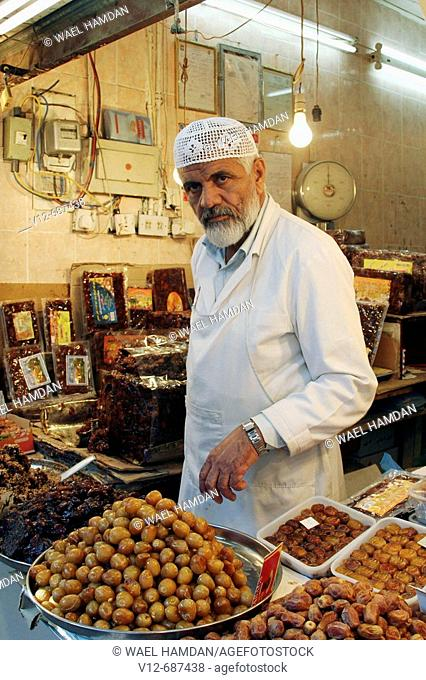 Man sales date in shop at old market, Kuwait City, Kuwait