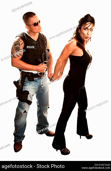 Policeman arresting pretty woman