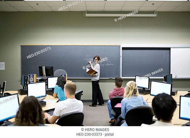 College professor leading lesson in computer lab classroom