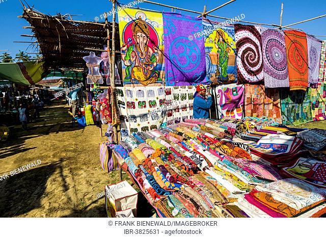 Colourful fabrics for sale at the weekly flea market, Anjuna, Goa, India