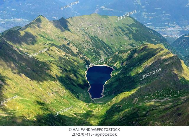 aerial shot, from a small plane, of Devil lake on northern ridge, shot on a bright summer day in Orobie, Bergamo, Lombardy , Italy