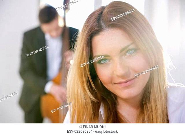 Face of smiling young woman on sunlight