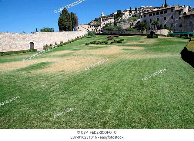 exceptional garden in front of the Basilica of Assisi with Tau and Pax in grass