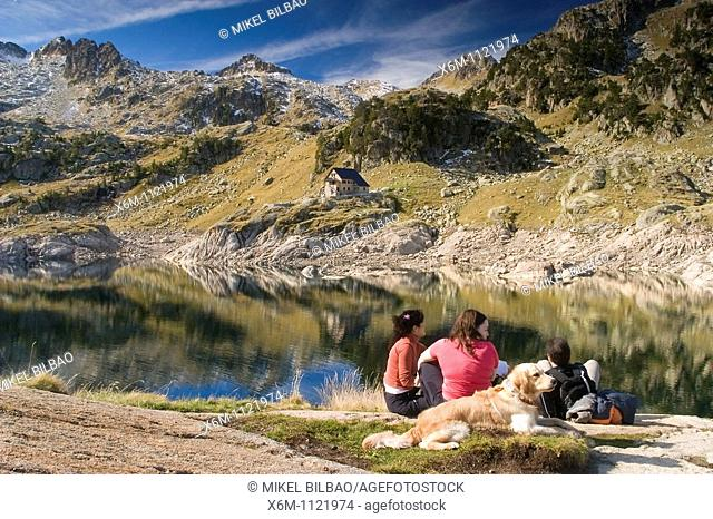 people near the Bigger Lake of Colomer and Colomer I mountain hut  Colomers glaciar cirque  Aran Valley  Pyrenees mountain range  Lerida province  Catalonia