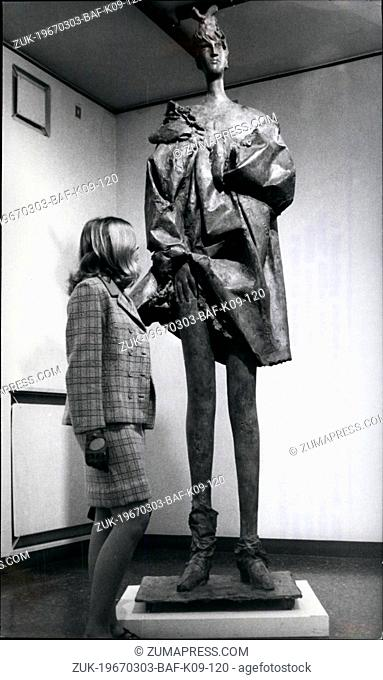 Mar. 03, 1967 - Looking somewhat perplexed a visitor looks at the bronze statue called 'Grand Strip Tease' by Italian sculptor Giacomo Manzu'