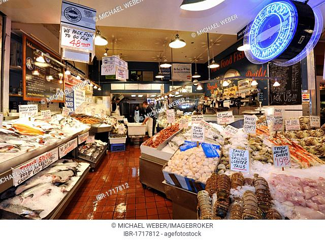 Fishmonger, fresh seafood, fish and crabs, on ice, Pike Place Public Market, Fish Market, Seattle, Washington, USA