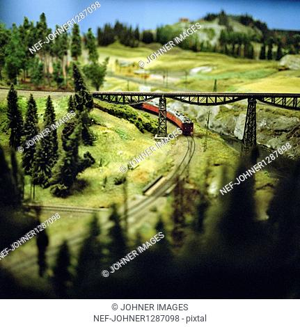 Train model driving through landscape