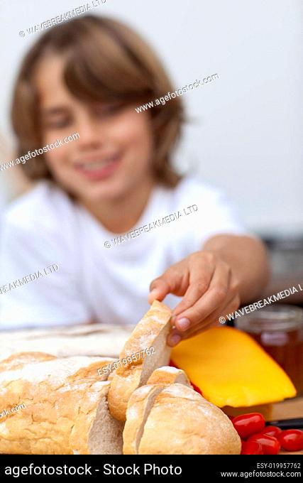 Smiling child taking a piece of bread