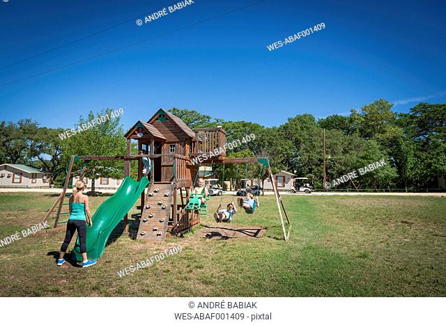 USA, Texas, Playground with children and mother