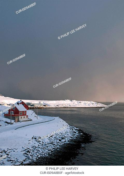 Small houses in Hovoysund. Deliveries of supplies and transport from large cruise ships enable small communities like this to survive their isolation during...