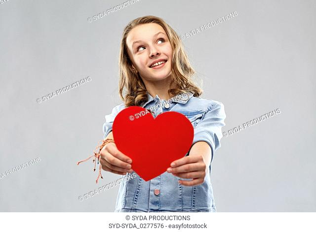 smiling teenage girl with red heart