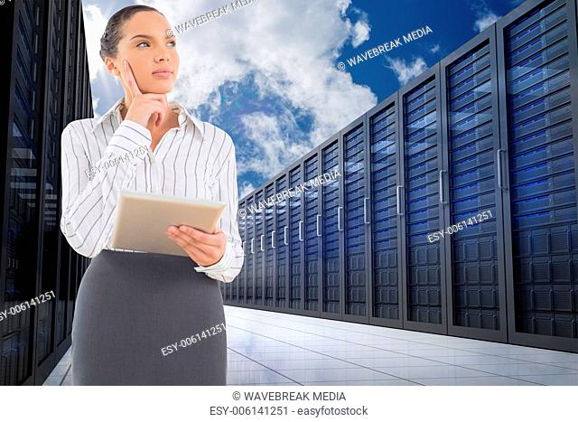 Composite image of confused businesswoman using a tablet pc