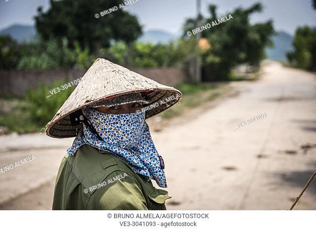 Vietnamese farmer in Dong Tam (Ninh Binh province, Vietnam)