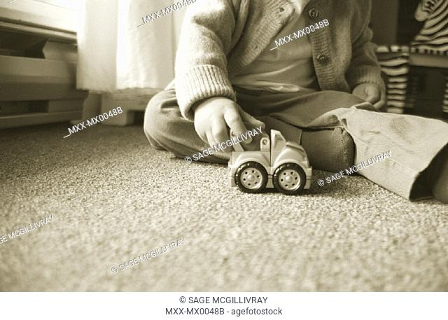 Toddler playing with toy