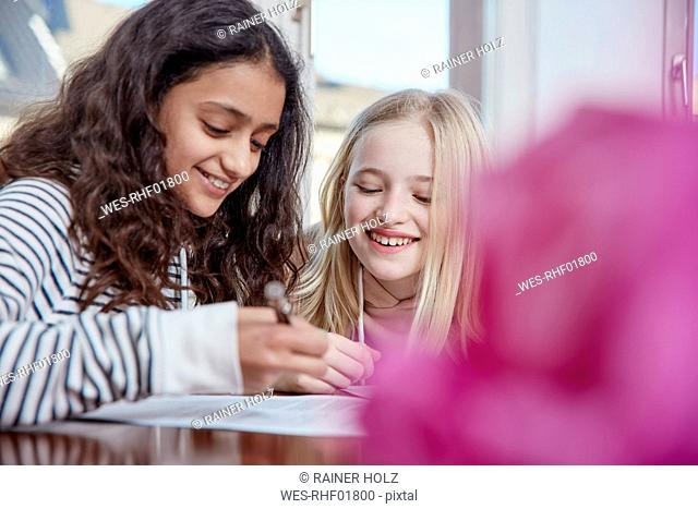Two girls doing homework together