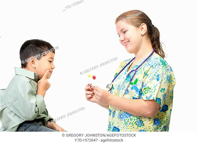 A nurse gives her little patient a choice between two different suckers