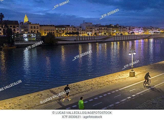 Paseo Alcalde Marqués del Contadero, in background Guadalquivir river and Triana quarter, Sevilla, Spain