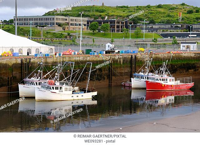 Fishing boats at dawn and low tide in Saint John Harbour New Brunswick