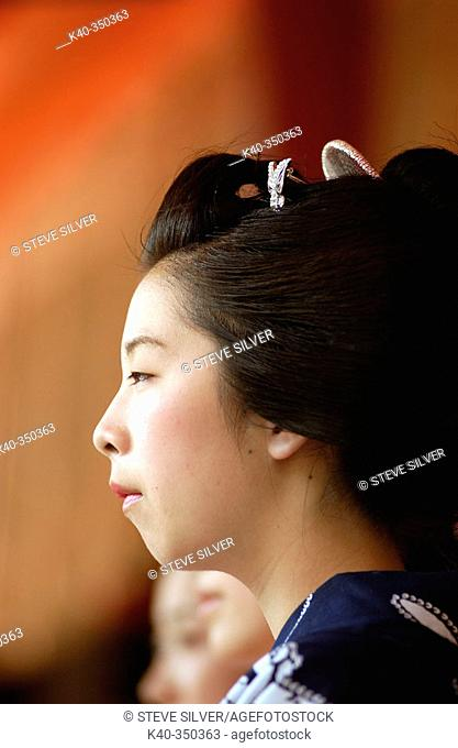 Woman in traditional costume at Hanagasa Junko (procession of floral bonnets) during Gion Matsuri traditional Japanese festival. Kyoto. Japan