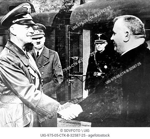 Jozef Tiso, accompanied by Slovak Premier Vojtech Tuka (r) is being greeted by German Foreign Minister von Ribbentrop as the two Slovak politicians arrive at...