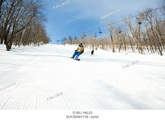 Two people snowboarding