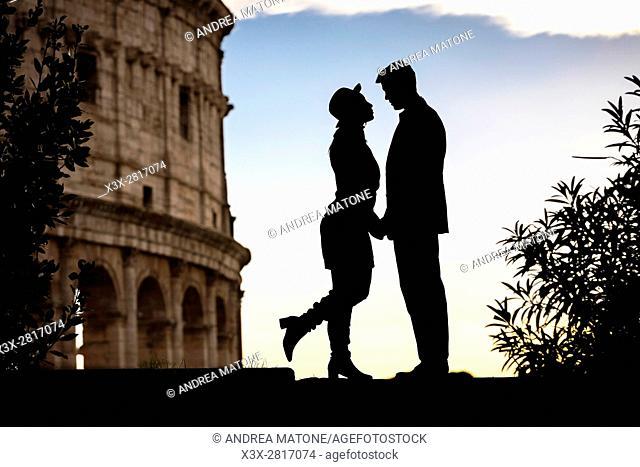 Couple silhouette. Roman Colosseum. Rome, Italy
