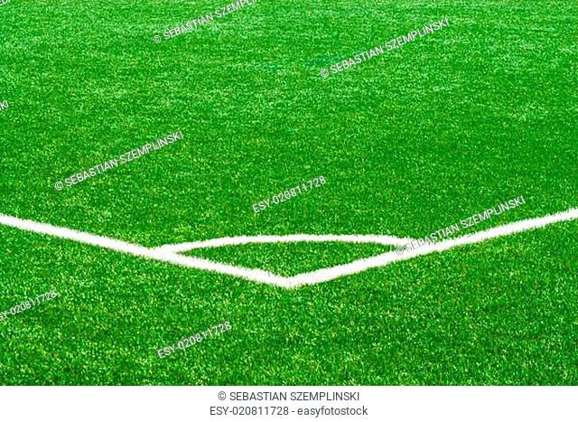 White corner marker on green sports turf