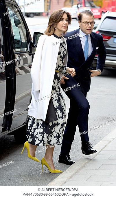 """Prince Daniel of Sweden and Crown Princess Mary of Denmark arrive at the Danish Embassy in Stockholm, on May 30, 2017, on occasion of the event """"""""Liveable..."""