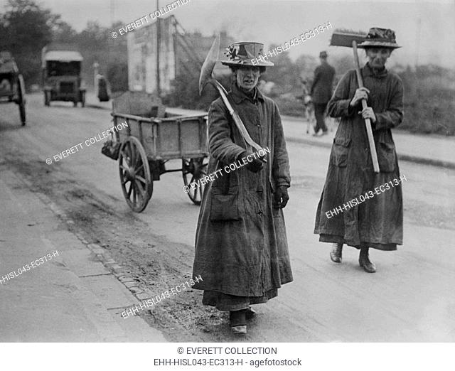 English women street cleaners during World War I, 1914-1918. They have replaced men who joined the armed forces. (BSLOC-2016-13-127.jpg )