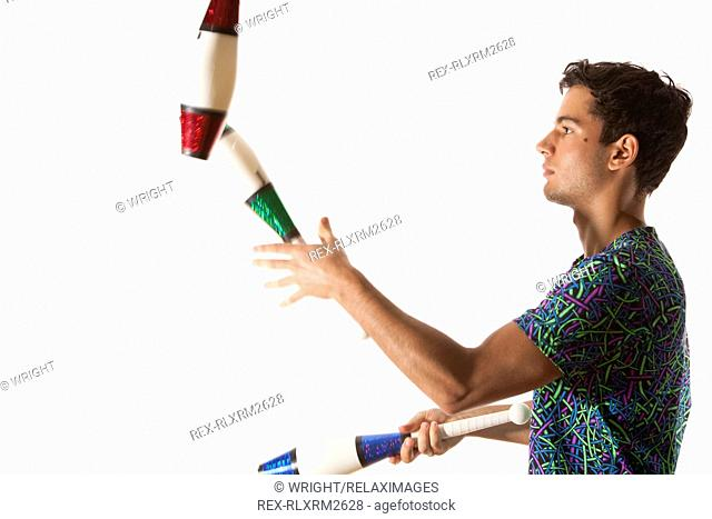 juggler Teenager juggling male pins side profile