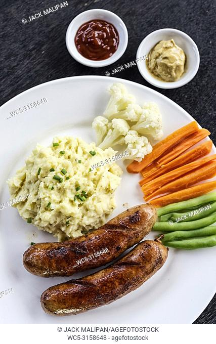 german sausage with mashed potato and vegetables simple meal