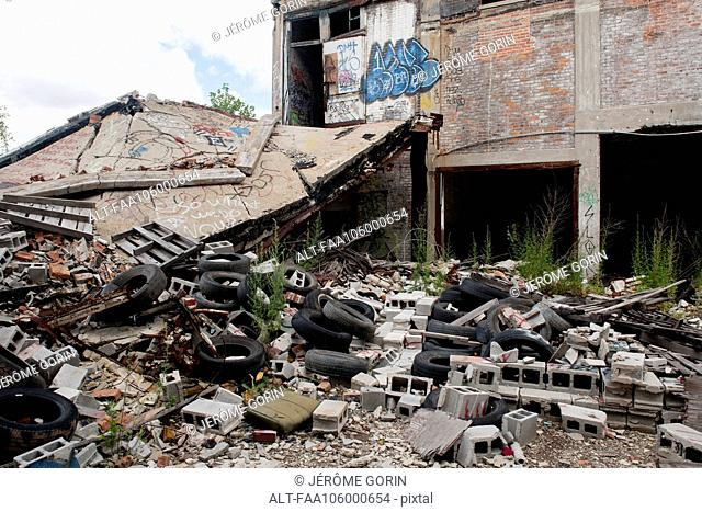 Trash and rubble heaped beside abandoned building in Detroit, Michigan, USA
