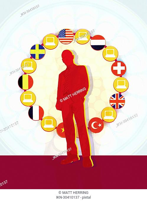 Circle of flags and computers surrounding businessman