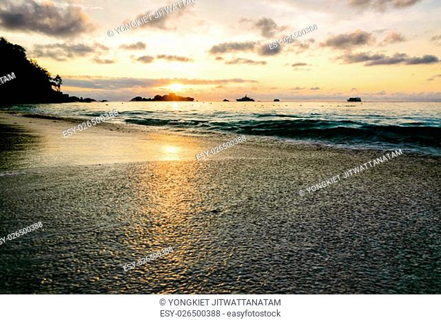Beautiful landscape morning sky over the sea and beach at Honeymoon Bay during sunrise is a famous attractions for diving on Miang island in Mu Koh Similan...