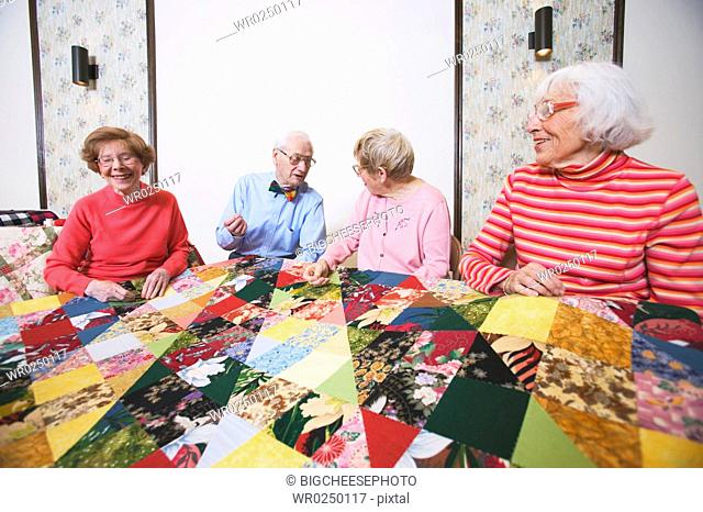 Seniors interacting at a quilting bee