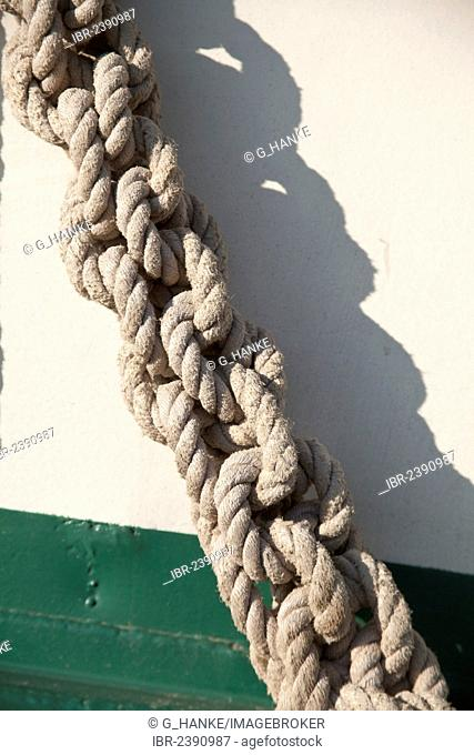 Knotted rope, detail view of a small sailing ship in the harbour of Greifswald, Mecklenburg-Western Pomerania, Germany, Europe