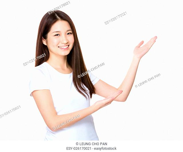 Young woman with hand showing blank sign