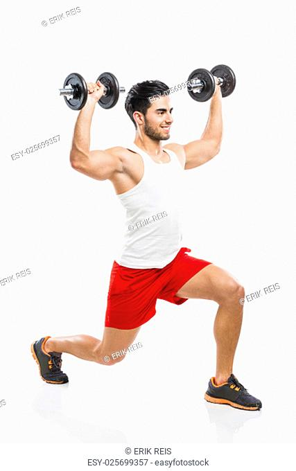 Portrait of handsome young man lifting weights, isolated on white background
