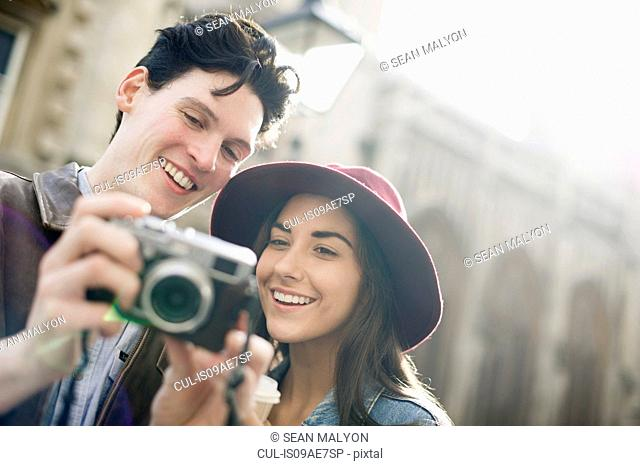 Young couple with vintage camera