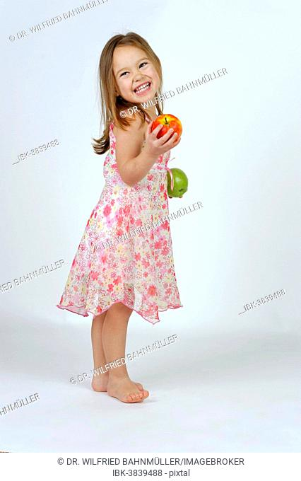 Girl with a red and a green apple
