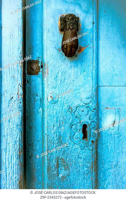 Knocker and locks of a house in Sepulveda, Segovia province, Castilla-Leon, Spain