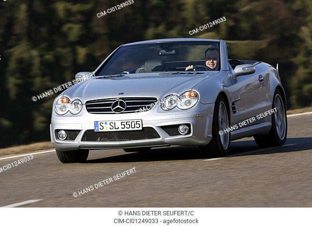 Mercedes SL 55 AMG, model year 2006-, silver, driving, diagonal from the front, frontal view, country road, open top