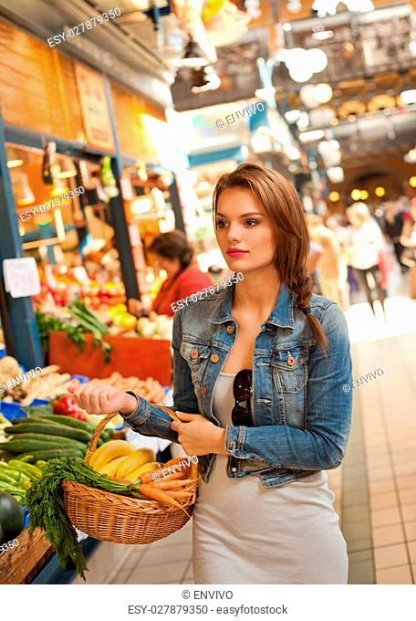 Portrait of a gorgeous young brunette woman shopping for groceries