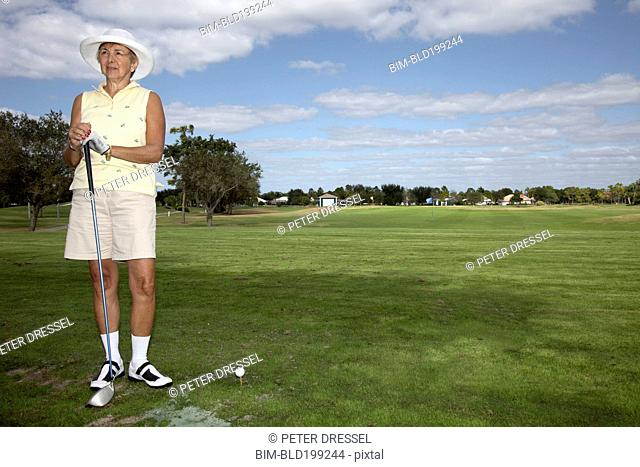 Senior Caucasian woman playing golf