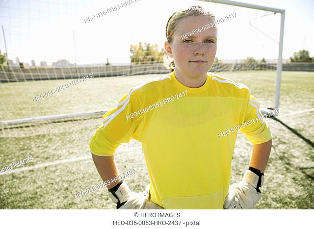 Teenage soccer goalie with serious look