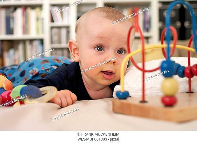 Germany, Hesse, Frankfurt, Baby boy playing with toy