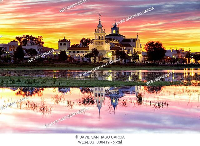 Spain, Andalusia, Huelva province, Donana National Park, El Rocio village and church at dusk