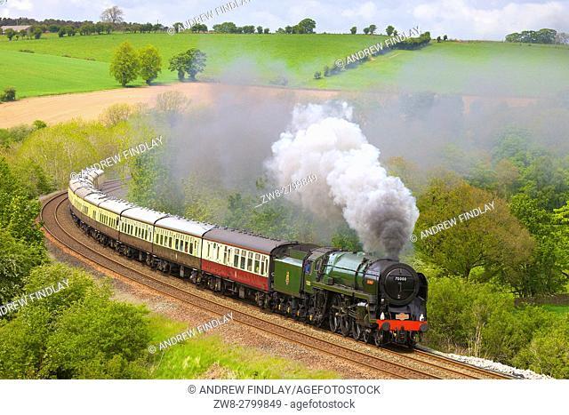 Steam train Britannia on the embankment at Low Baron Wood Farm, Armathwaite, Settle to Carlisle Railway Line, Eden Valley, Cumbria, England, UK